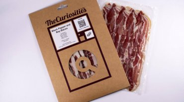 Parkside develops compostable film laminate for Curiosities' cured bacon range