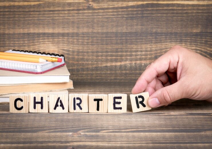 Charter.,Wooden,Letters,On,The,Office,Desk,,Informative,And,Communication