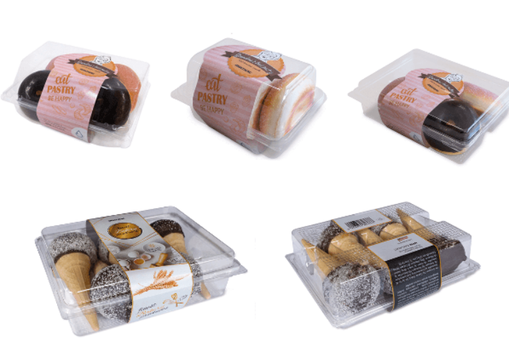 Full wrap labelling solution for bakery products in hinged trays